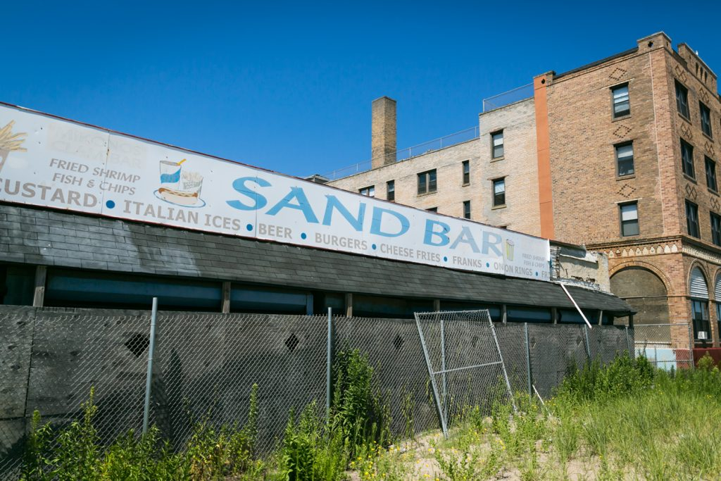 Sand Bar restaurant sign and fence in Far Rockaway