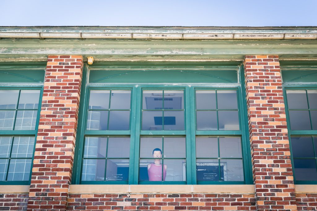 CPR dummy seen through window in building