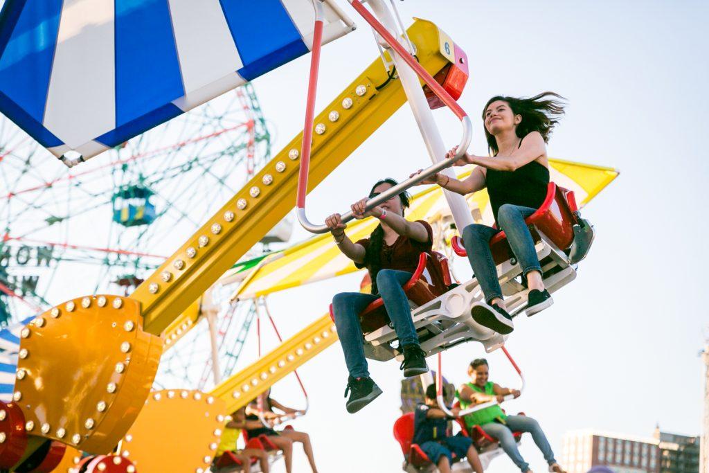 People riding carnival ride in Coney Island, Brooklyn