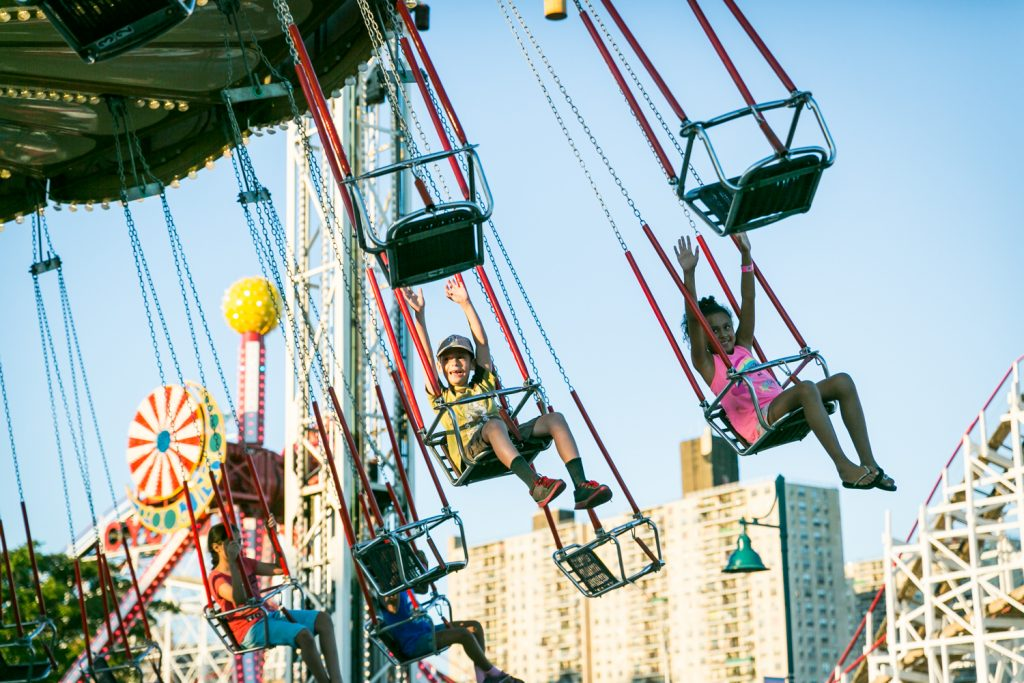People riding carnival ride in Coney Island, Brooklyn