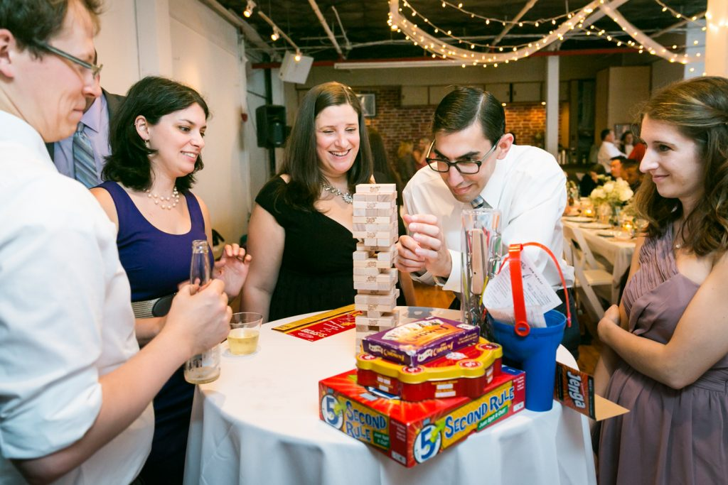 Guests playing Jenga at a wedding reception