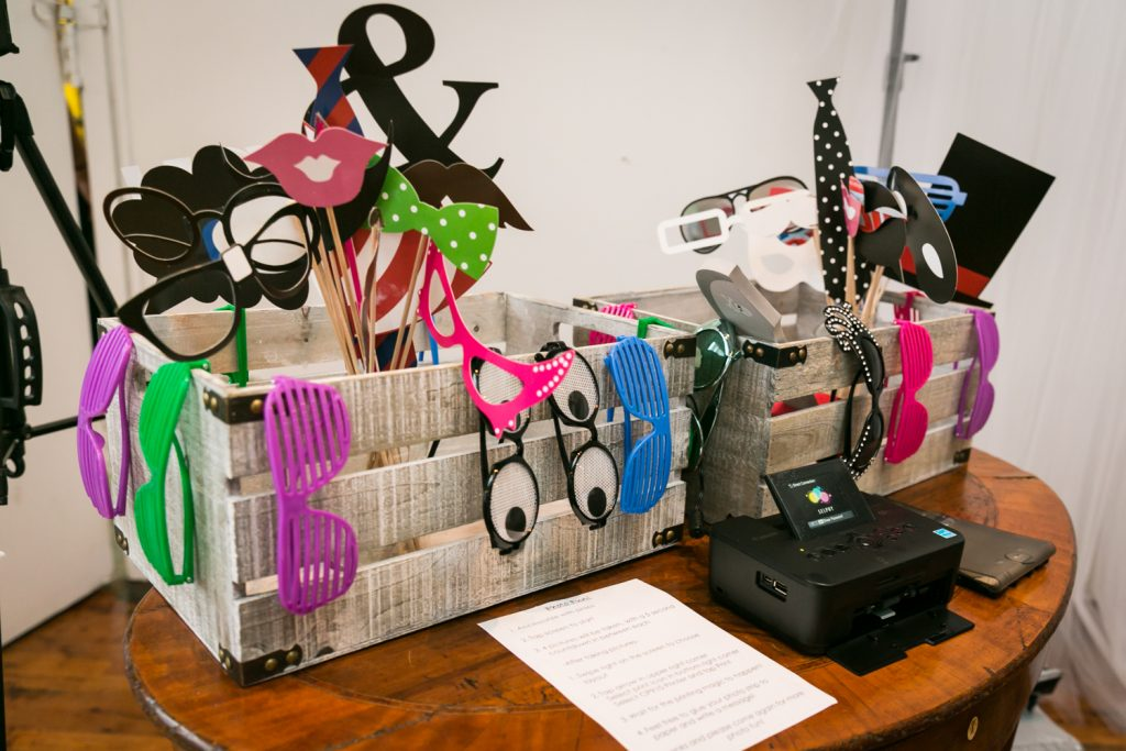 Selection of colorful photo booth props for an article on event entertainment ideas