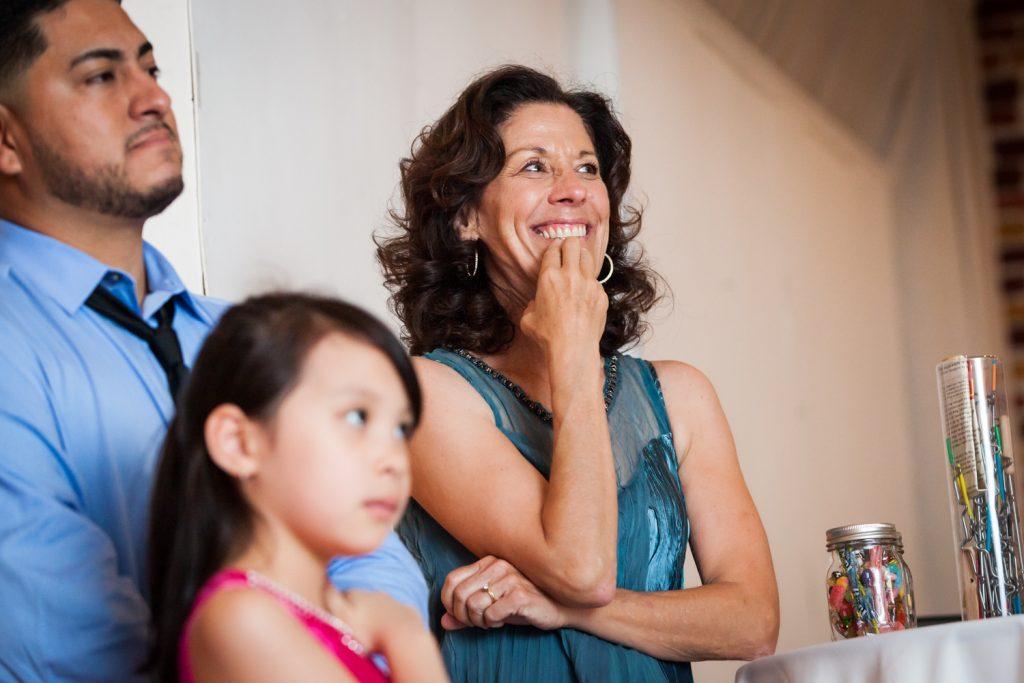 Woman listening to speeches at Astoria wedding reception