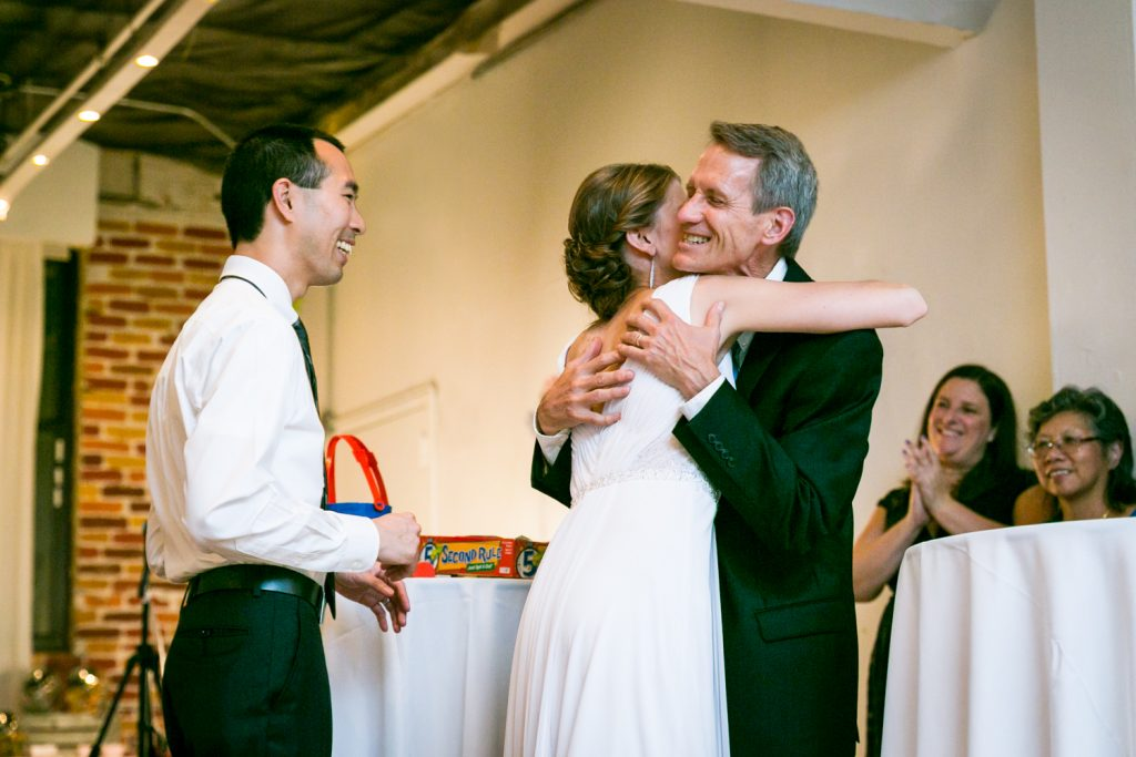Bride hugging father after speech at Astoria wedding reception