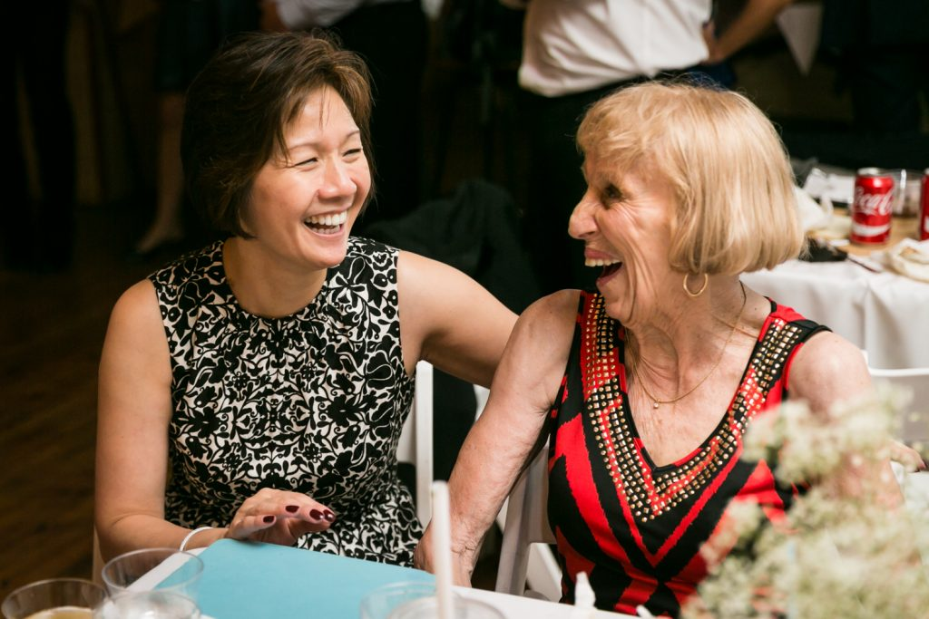 Two older women laughing at Astoria wedding reception