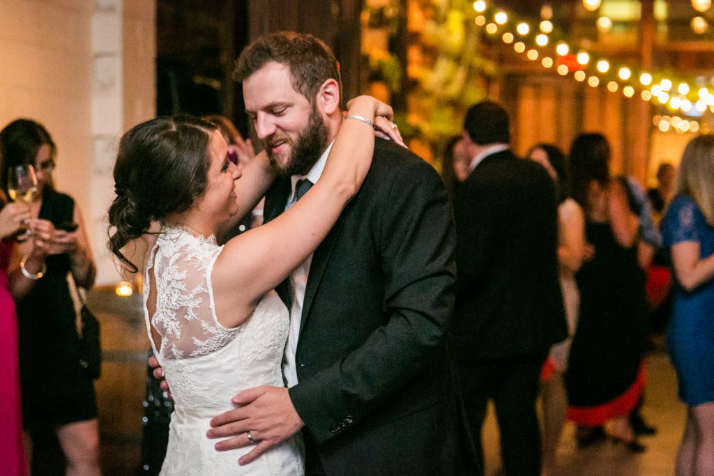 Bride and groom dancing in corner for article on how to get the perfect first dance photos