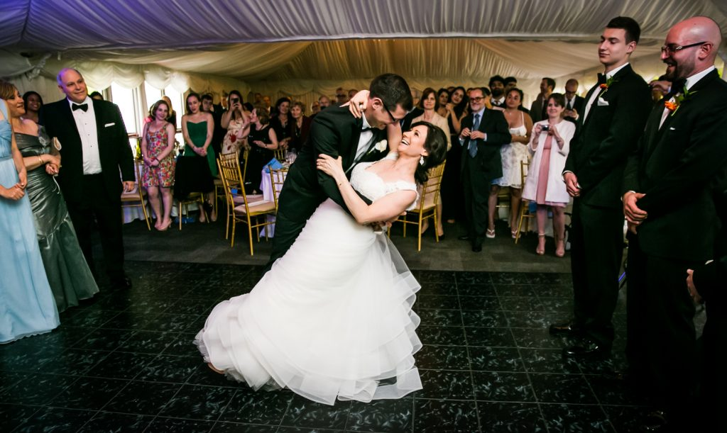 Groom dipping bride during first dance for article on how to get the perfect first dance photos