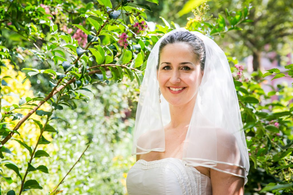 Portrait of bride in front of flowers and plants at a DUMBO Loft wedding