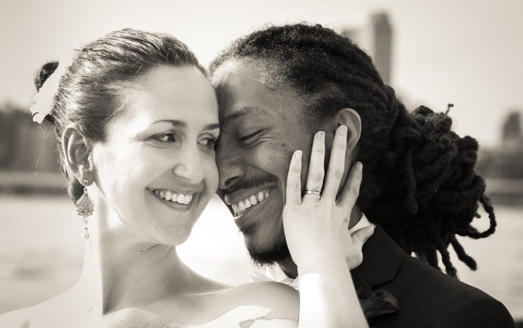 Black and white photo of bride touching groom's cheek