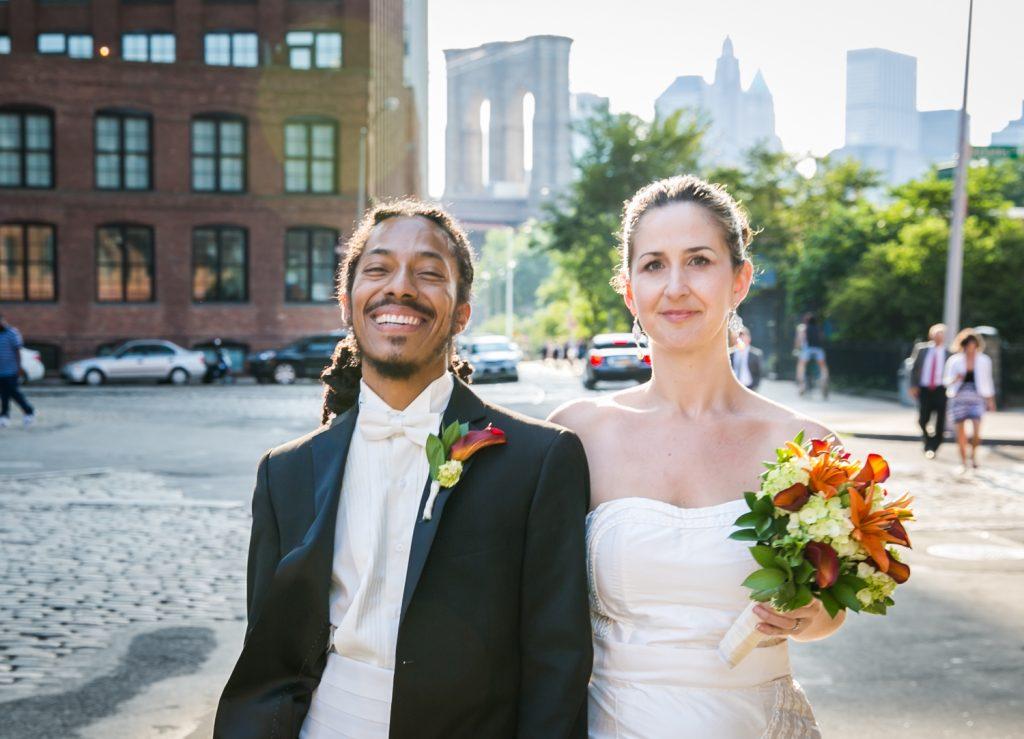 Bride and groom walking from Brooklyn Bridge Park