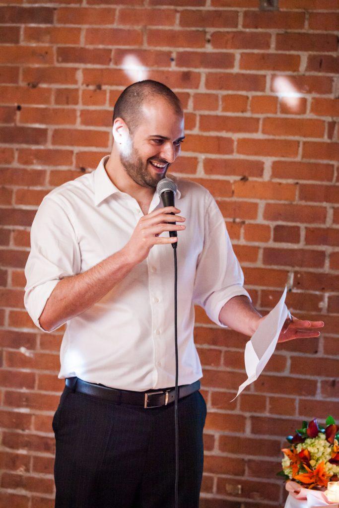 Best man giving a speech at a DUMBO Loft wedding