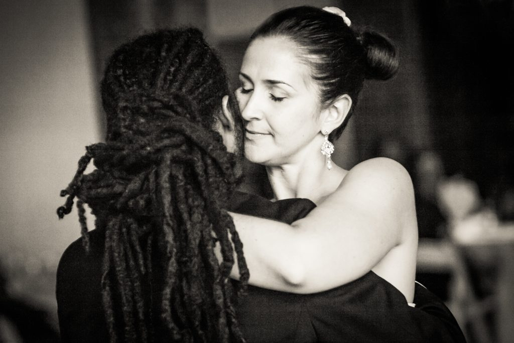 Black and white first dance photos of bride and groom at a DUMBO Loft wedding in Brooklyn