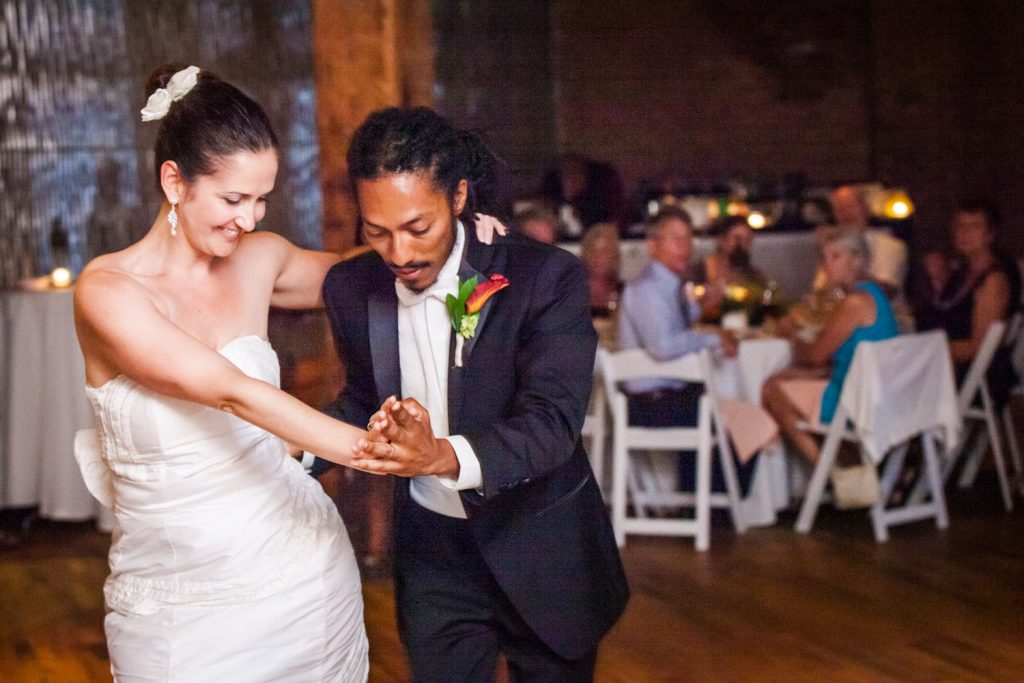 First dance photos of bride and groom at a DUMBO Loft wedding in Brooklyn