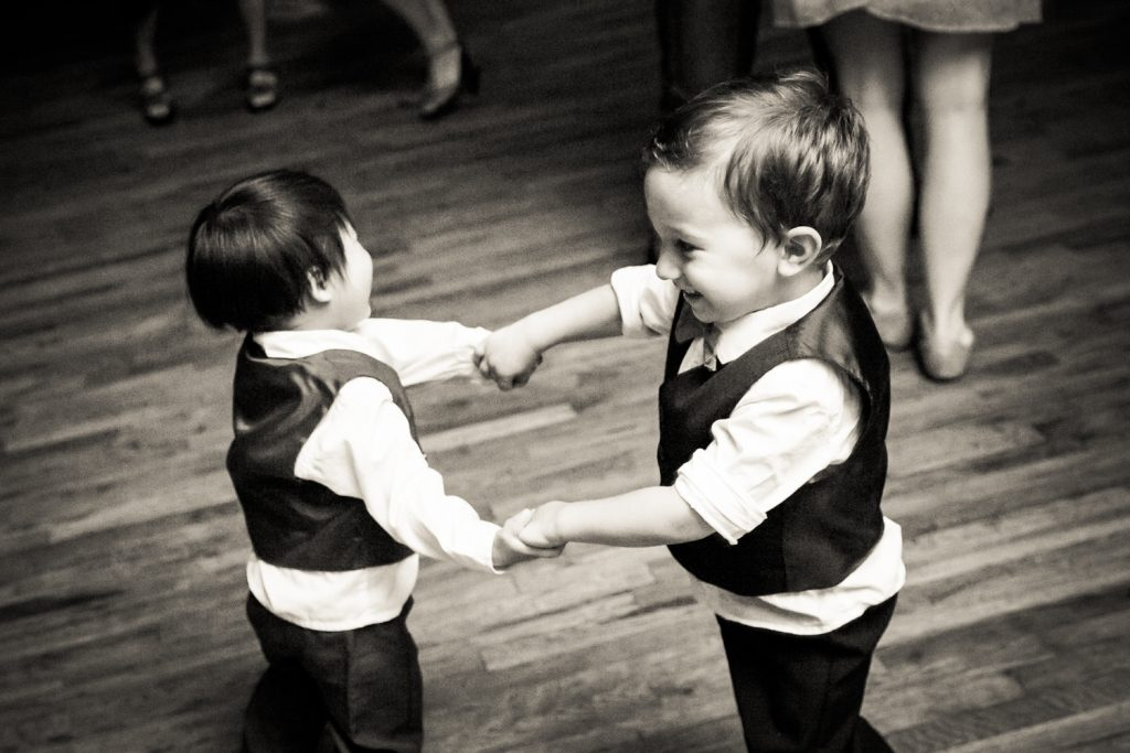 Black and white photo of two little boys dancing together