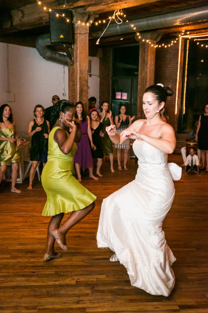 Bride and guest dancing at a DUMBO Loft wedding