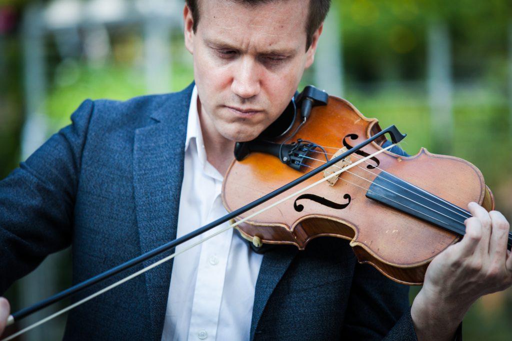 Close up of man playing violin