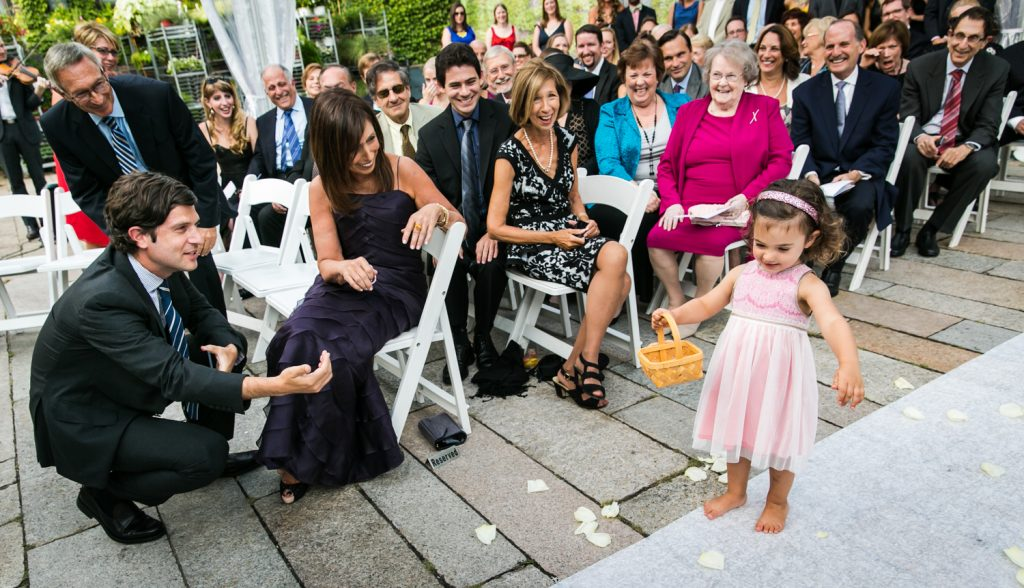 Little flower girl walking down aisle for an article on how to become a wedding officiant in NYC