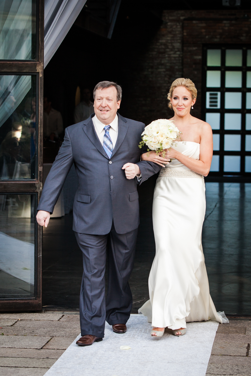 Bride and father walking down aisle for an article on how to become a wedding officiant in NYC