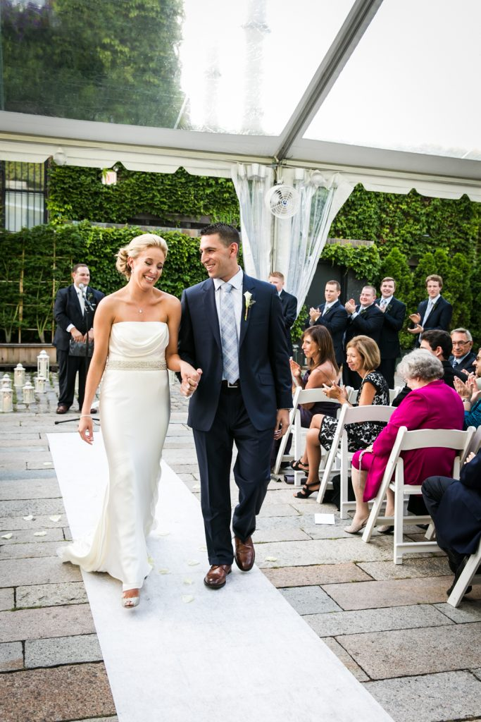 Bride and groom walking down aisle after ceremony for an article on how to become a wedding officiant in NYC