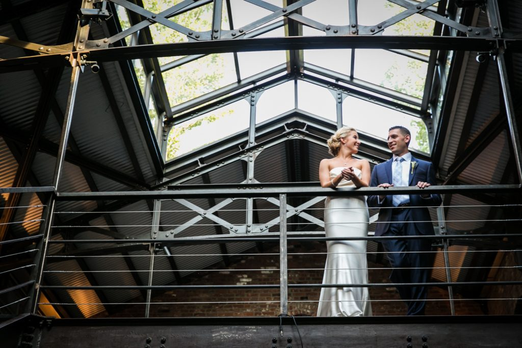 Bride and groom on mezzanine level for an article on how to become a wedding officiant in NYC