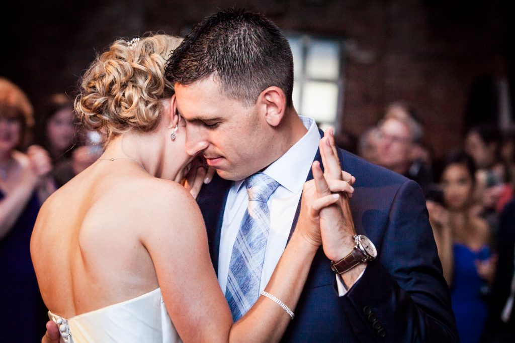Bride and groom during first dance for an article on how to become a wedding officiant in NYC