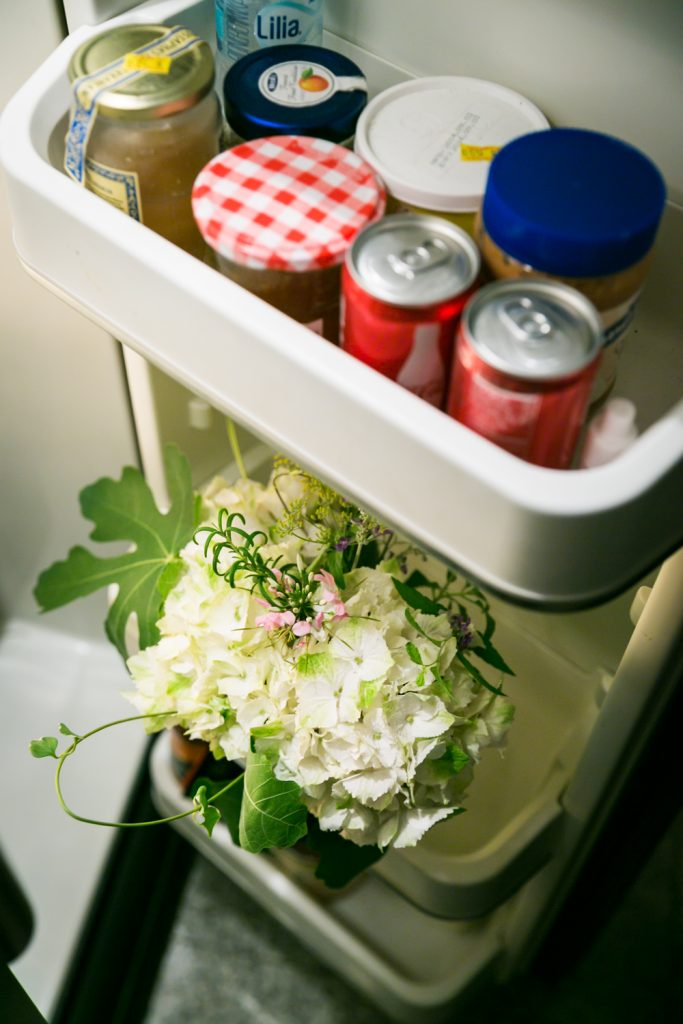 White bouquet of flowers in the door of a refrigerator
