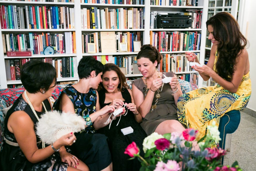 Female guests opening gifts at a NYC rehearsal dinner