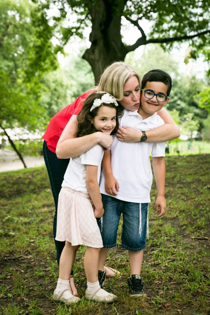 Prospect Park family photos woman in red hugging two children