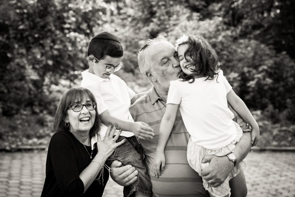 Black and white Prospect Park family photos of grandparents holding two grandkids