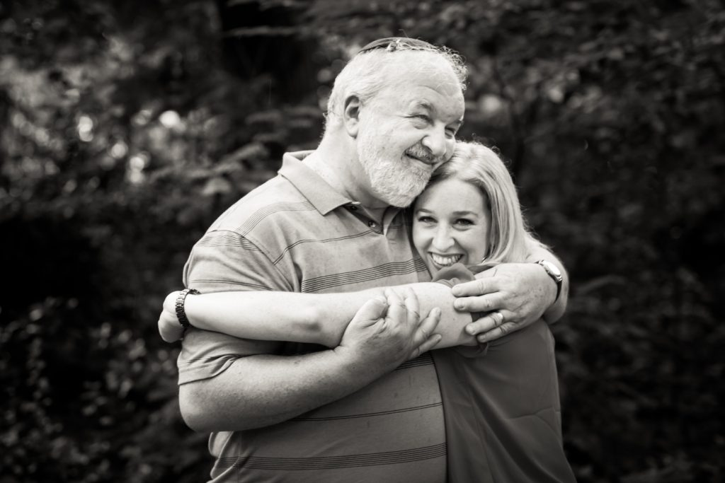 Black and white photo of father hugging daughter