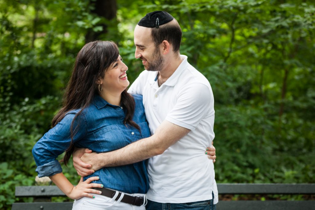 Couple hugging and looking at each other in Prospect Park