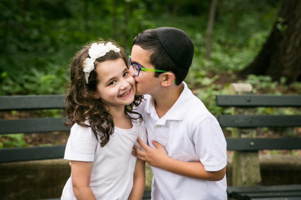 Little boy kissing little girl in Prospect Park
