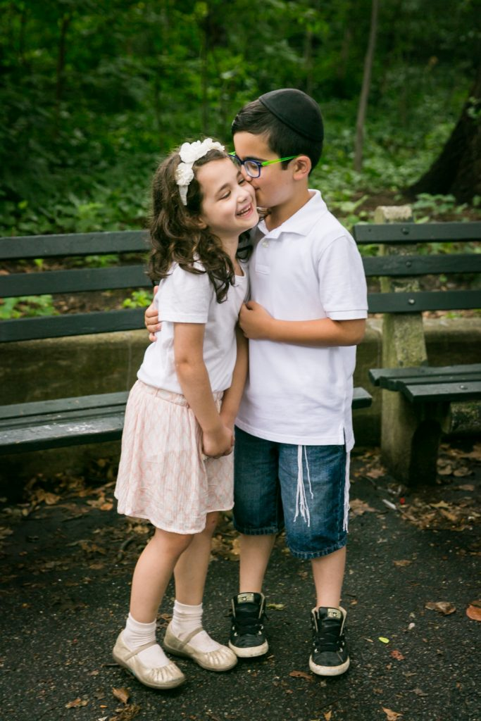 Little boy kissing little girl in Prospect Park