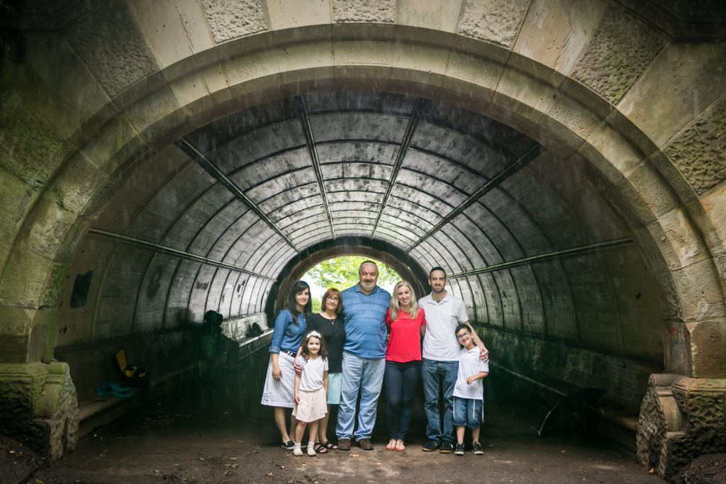 Family of seven posed under arch in Prospect Park
