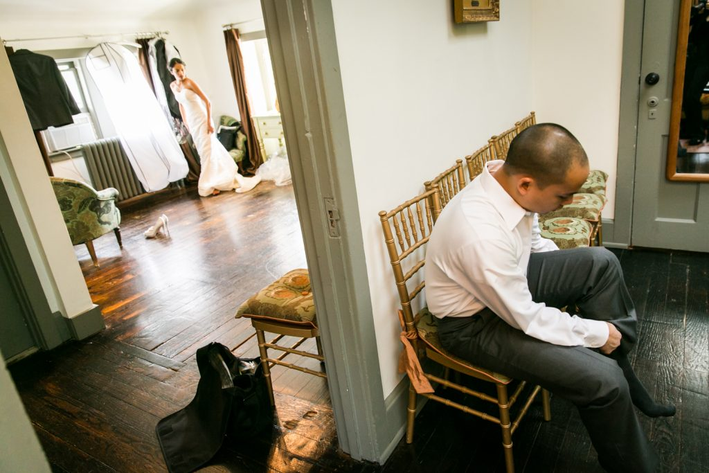 Bride and groom getting ready in separate rooms for an article on when should my wedding photographer arrive
