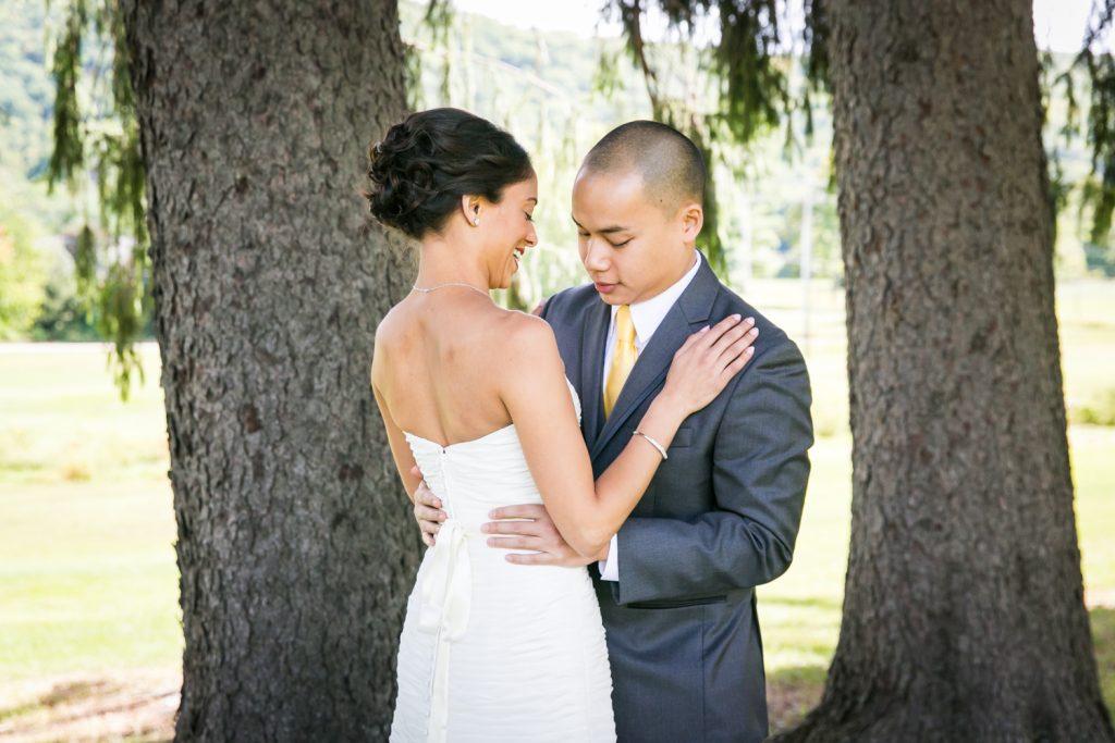 Groom looking at bride during first look