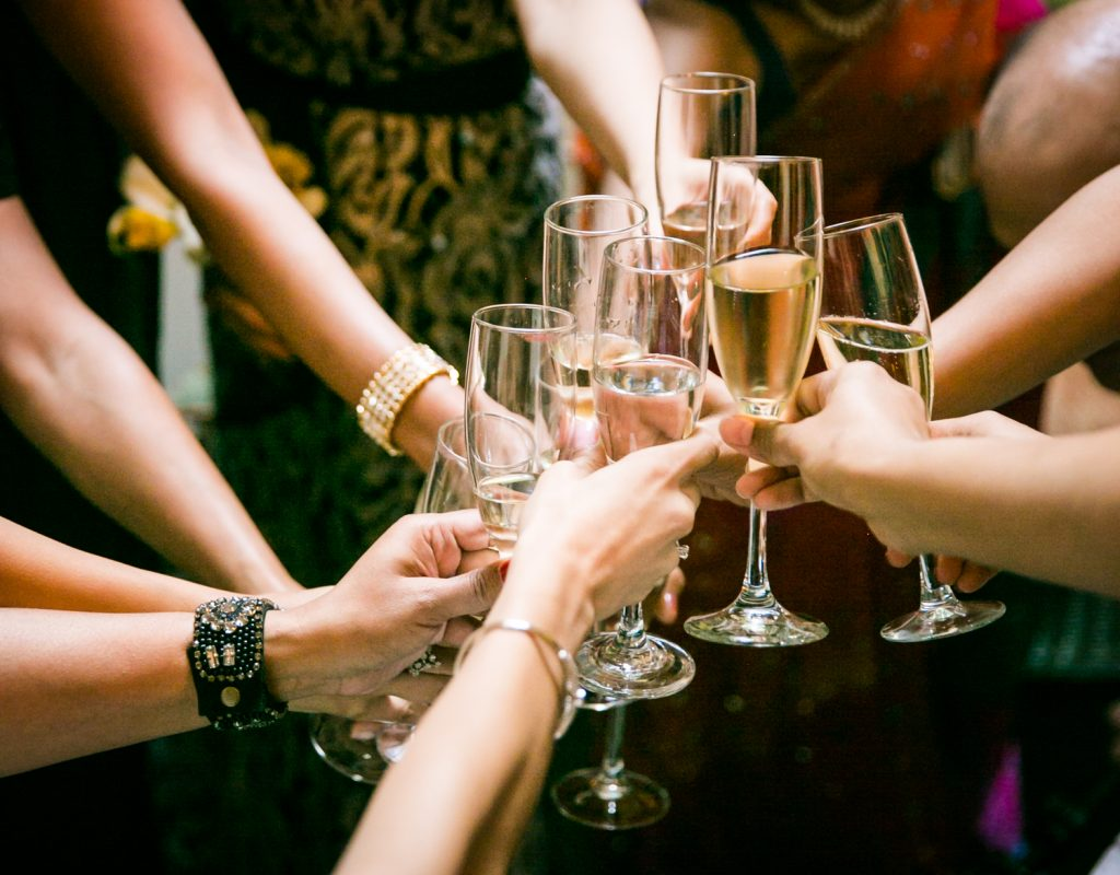 Close up of hands toasting chapagne glasses
