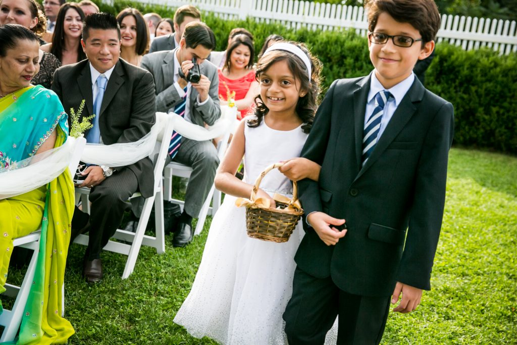 Flower girl and young boy walking down aisle at Highlands Country Club wedding ceremony