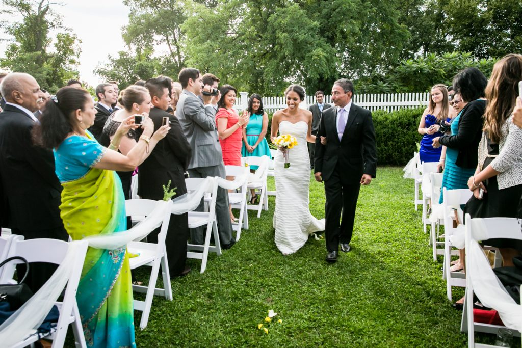 Bride walking down aisle at Highlands Country Club wedding ceremony