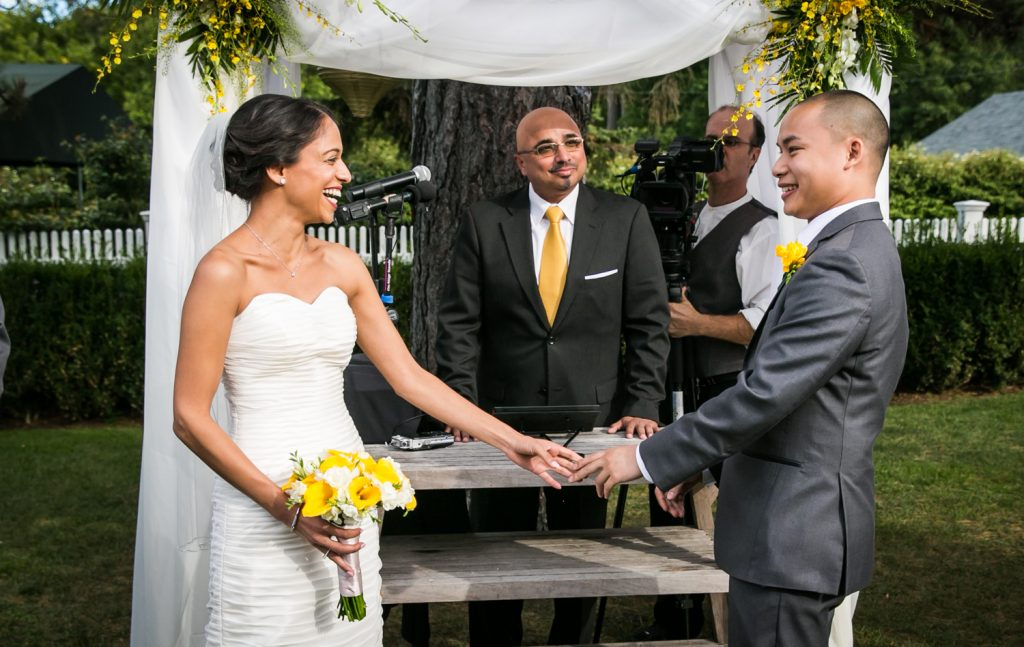 Bride and groom holding hands at Highlands Country Club wedding ceremony