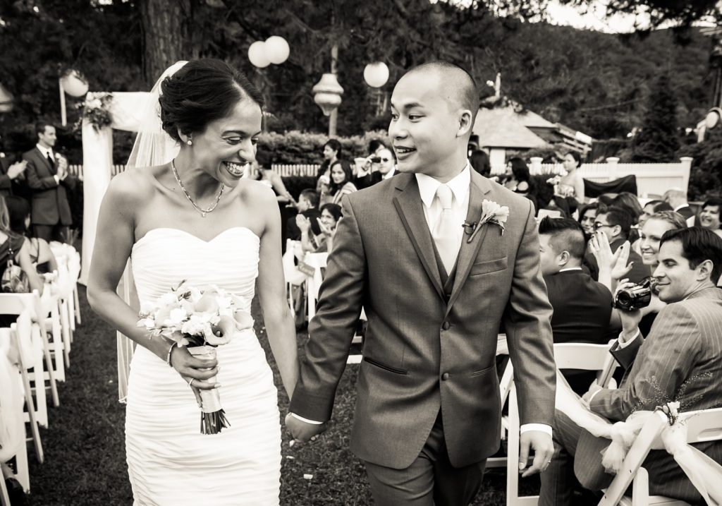 Black and white photo of bride and groom walking down aisle at Highlands Country Club wedding ceremony