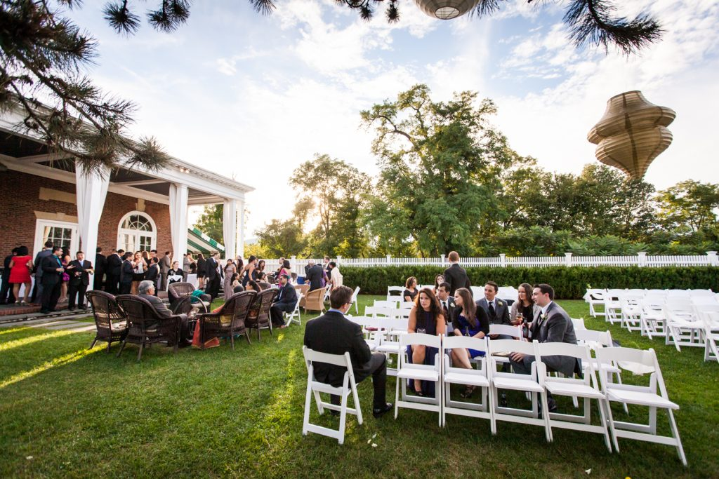 Guests seated outside for cocktail hour at Highlands Country Club wedding ceremony