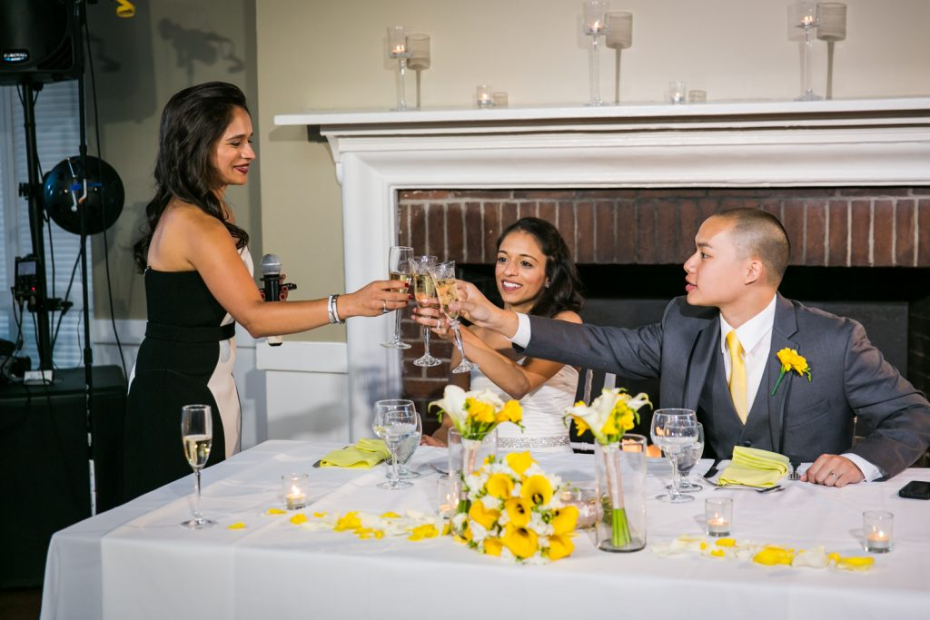 Bridesmaid toasting champagne glass with bride and groom at Highlands Country Club wedding ceremony
