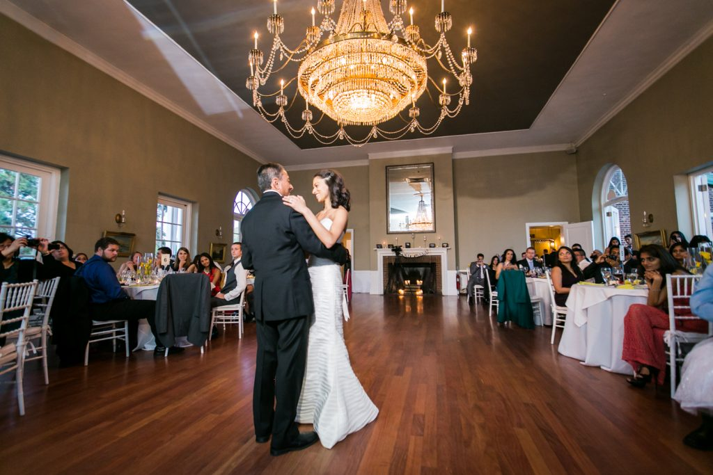 Bride dancing with father underneath chandelier at Highlands Country Club wedding ceremony