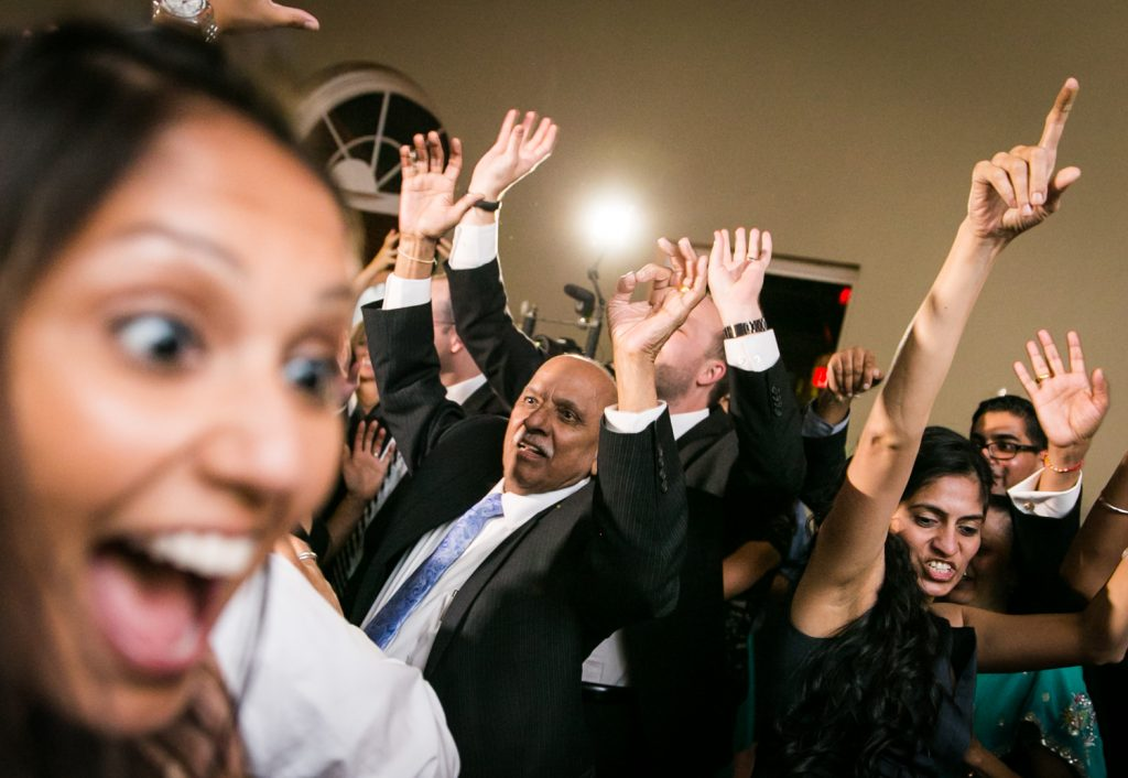 Guests dancing with hands raised at Highlands Country Club wedding