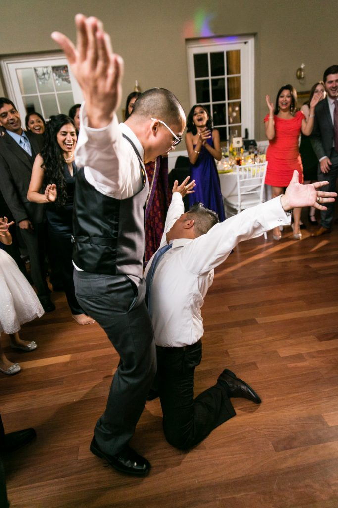 Two guests dancing with arms raised at Highlands Country Club wedding