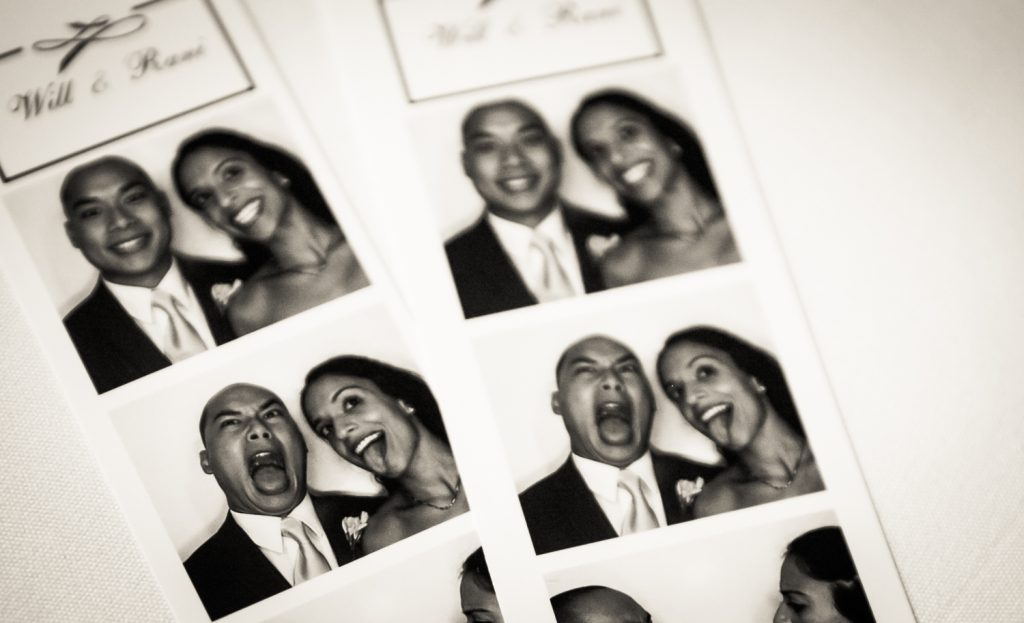 Black and white photo of photobooth strip of bride and groom making funny faces