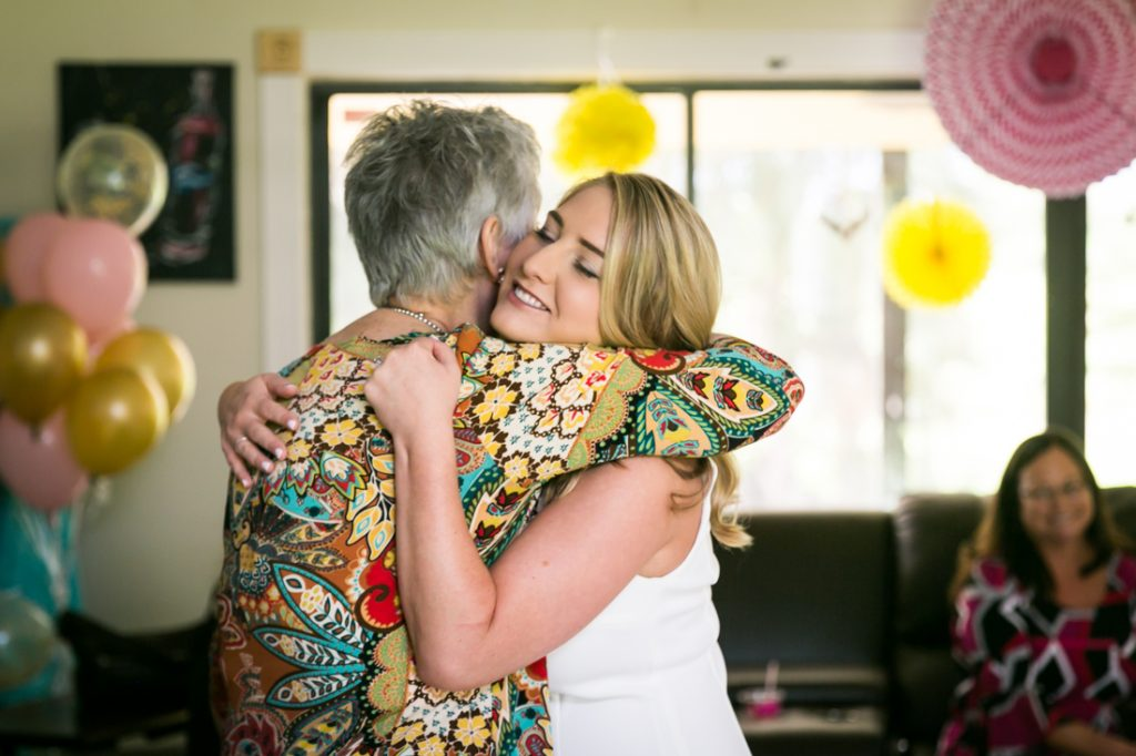 Bride-to-be hugging grandmother at a Florida bridal shower