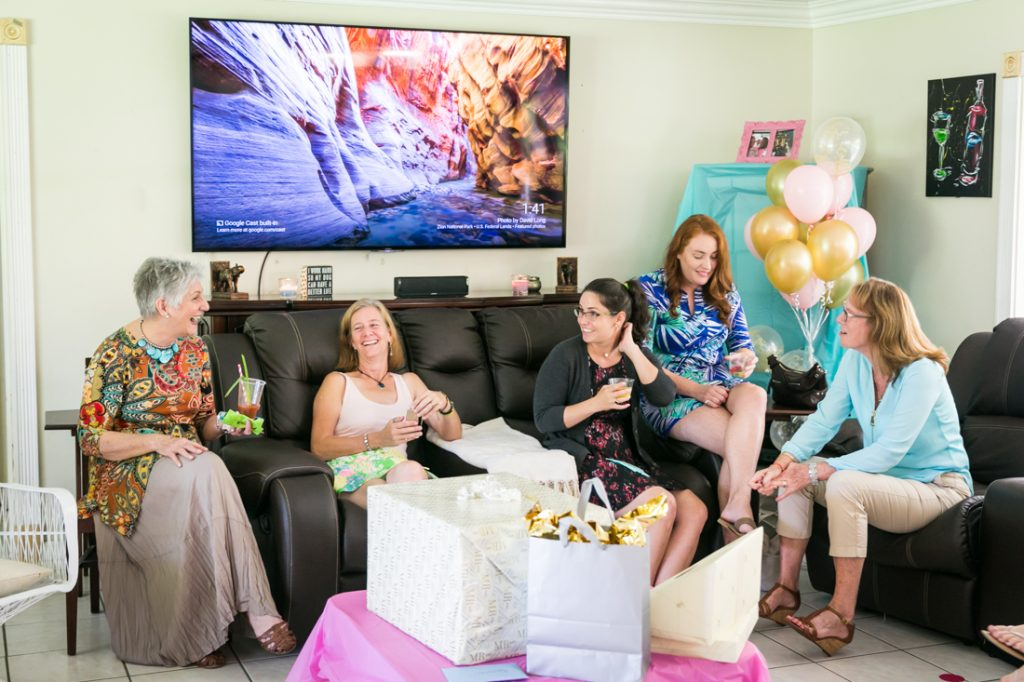 Guests chatting on a couch at a Florida bridal shower