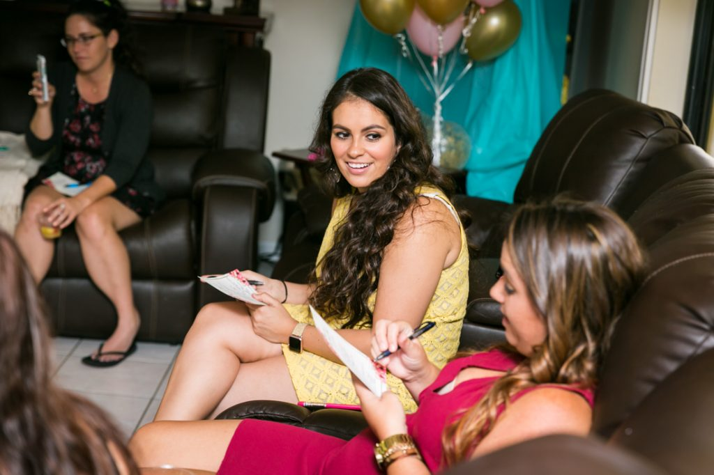 Female guests playing a game at a Florida bridal shower